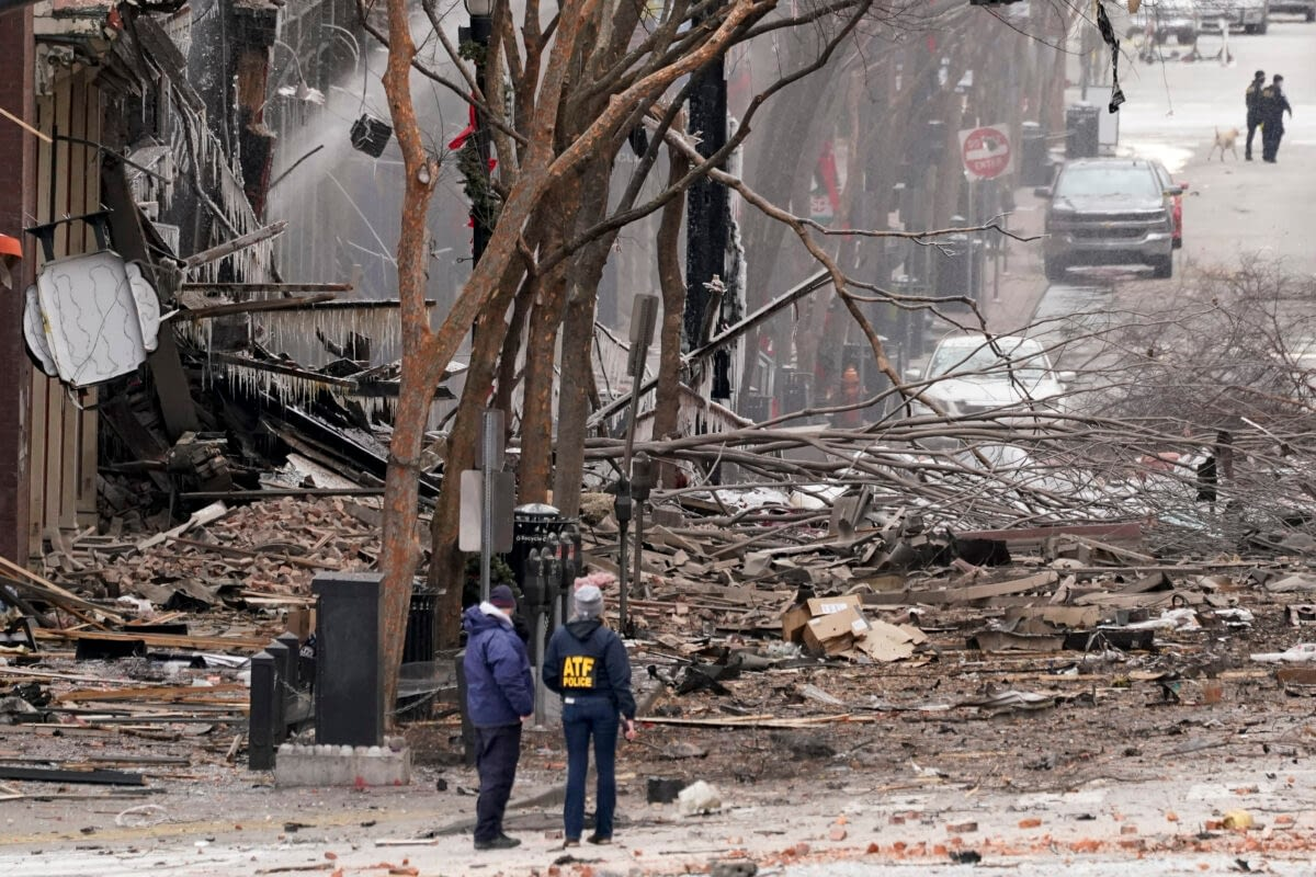 officers overlooking the damaged caused by the christmas morning bombing in Nashville, Tennesseee